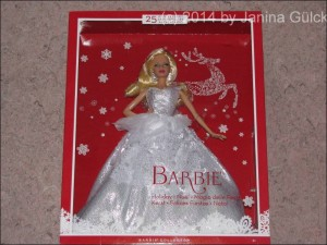 Holiday 2013 Barbie has a silver dress with white application
